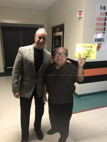Dr.Stranges posing with cardboard cutout of Danny DeVito